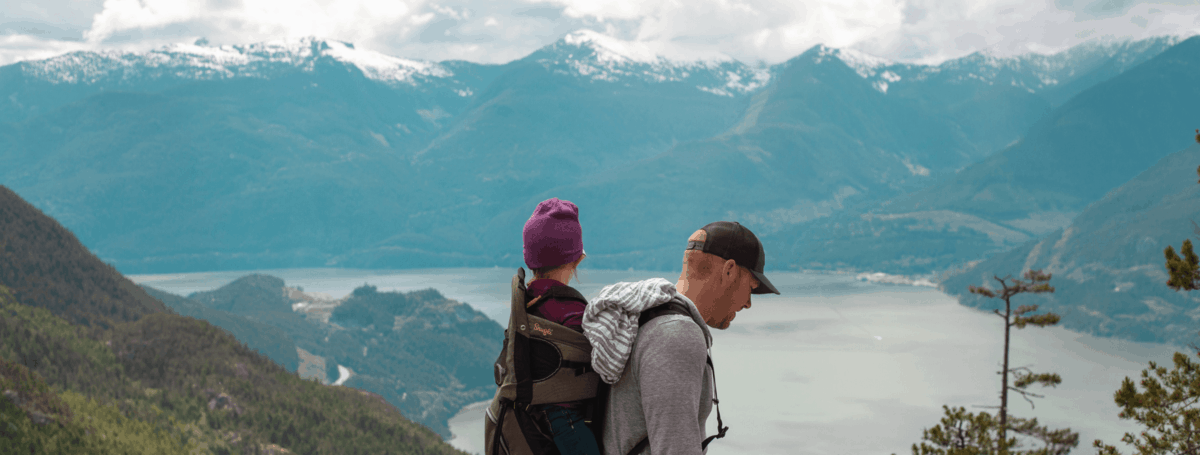 dad and baby hike in the mountains